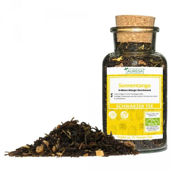 Mélange de thé vert et noir en vrac Sonnentango dans un verre